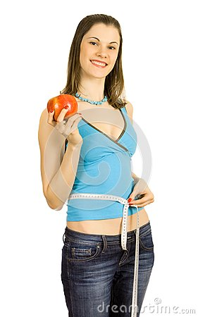 Pretty girl holding an apple; isolated on white