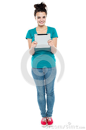 Pretty girl holding tablet pc