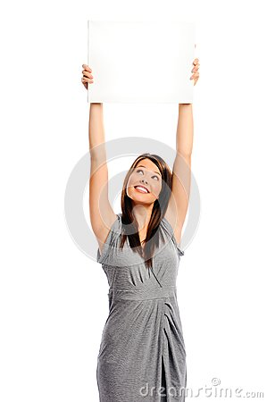 Pretty girl holding a white board