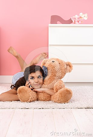 Pretty girl with huge soft toy bear