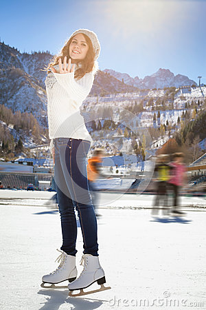 Free Pretty Girl Ice Skating Outdoor At Ice Rink Stock Image - 62964431