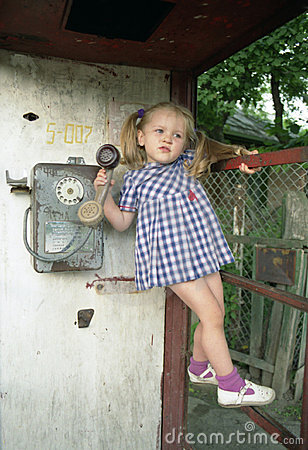 Free Pretty Girl In The Phone Booth Royalty Free Stock Photo - 517245