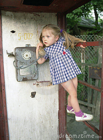 Free Pretty Girl In The Phone Booth Royalty Free Stock Image - 517246