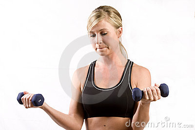 Pretty girl lifting two weights