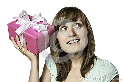 Pretty girl listens to a gift