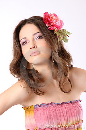 Pretty girl with long hair and flower-hairpin