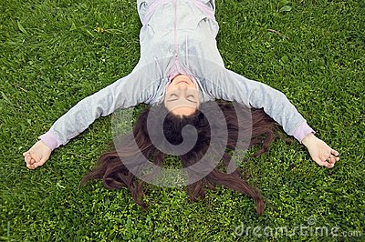 Pretty girl lying on the grass