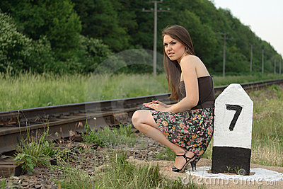 Pretty girl near railroad s traffic sign