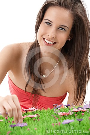 Pretty girl picking flowers