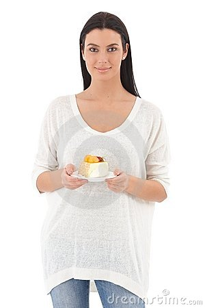 Pretty girl with a piece of cake smiling Stock Photo
