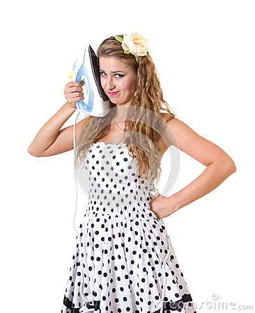 Pretty girl in pin-up style posing with iron