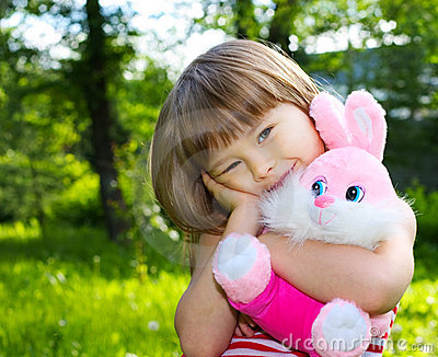 Pretty girl with pink soft rabbit
