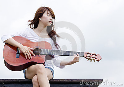 Pretty girl play guitar
