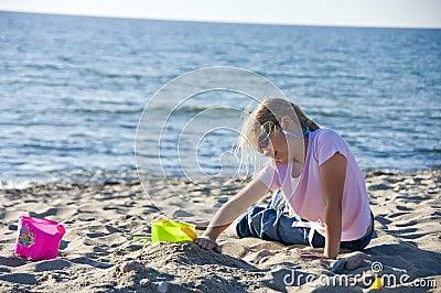 Pretty girl playing at beach
