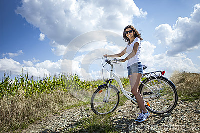 Pretty girl pose with bike