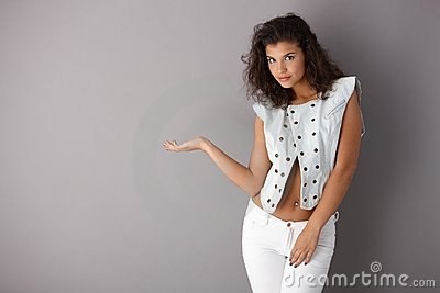 Pretty girl posing over gray background