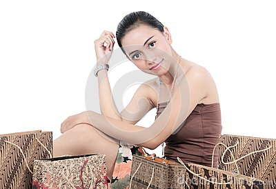 Pretty girl posing with shopping bags