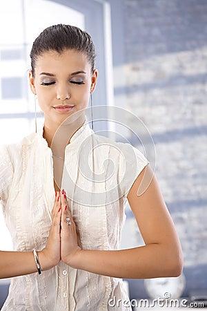 Pretty girl in prayer position