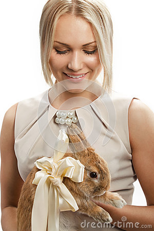 Pretty girl with a rabbit