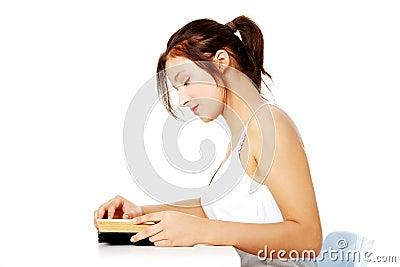 Pretty girl reading a book.