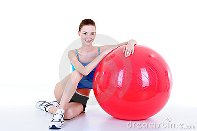 Pretty girl with red fitball