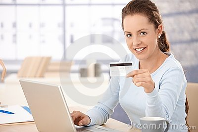 Pretty girl shopping on internet smiling