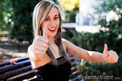 Pretty girl showing thumb up sign