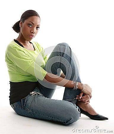 Pretty girl sitting on the floor