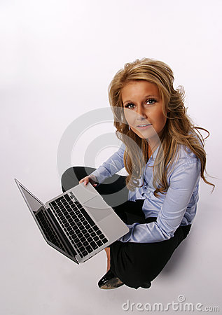 Pretty girl sitting with laptop computer