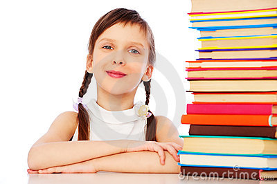 Pretty girl sitting near books