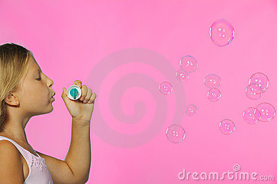 The pretty girl with soap bubbles