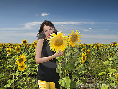 Pretty girl with sunflowers