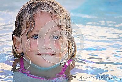 Pretty girl swimming