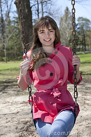 Pretty Girl on Swing in Park