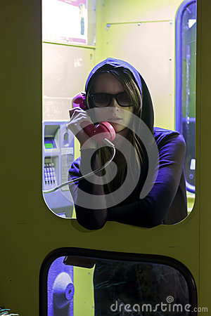 Free Pretty Girl Talking By The Payphone In Telephone Booth Royalty Free Stock Image - 48303096