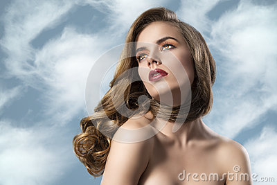Pretty girl with wavy hair and nacked soulders