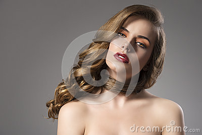 Pretty girl with wavy hair on shoulder and sensual