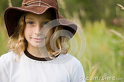 Pretty girl wearing a floppy sunhat
