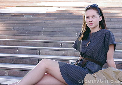 Pretty girl or woman sitting on the stairs