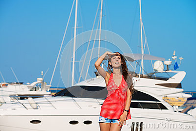 Pretty girl at the yacht harbor