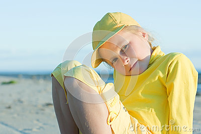 Pretty girl in a yellow ball cap