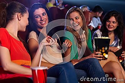 Pretty girls in cinema talking smiling