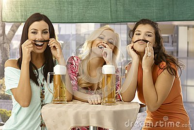 Pretty girls having fun and beer