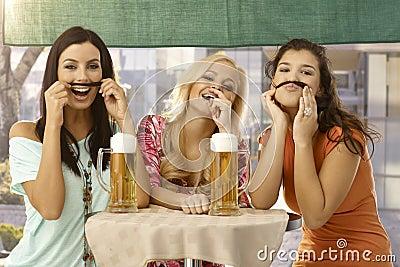 Pretty girls having fun and beer