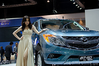 Pretty girls with Mazda. Editorial Stock Photo