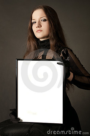 Pretty gothic girl with blank frame