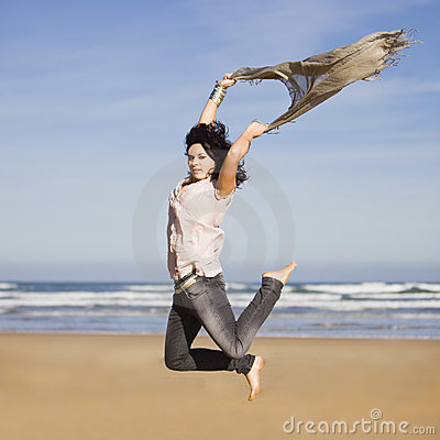 Pretty happy girl jumping