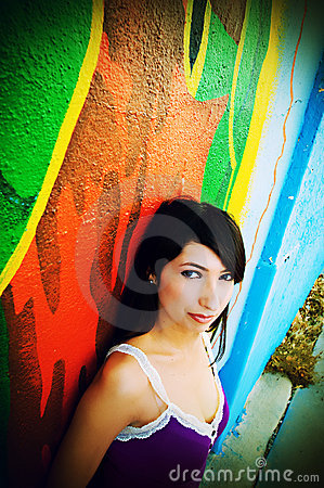 Pretty Hispanic Girl Against a Colorful Wall