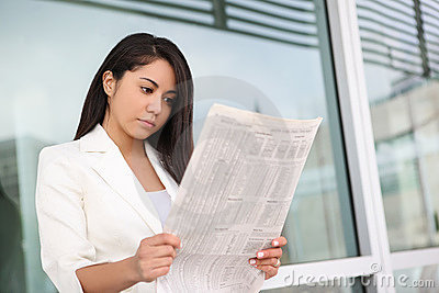 Pretty Hispanic Woman Reading Newspaper
