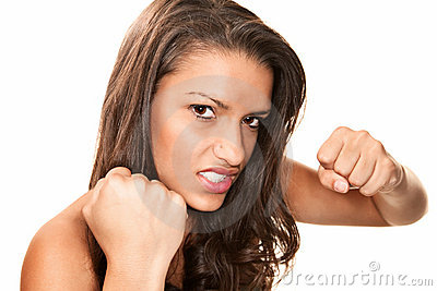 Pretty Hispanic Woman Throwing a Punch